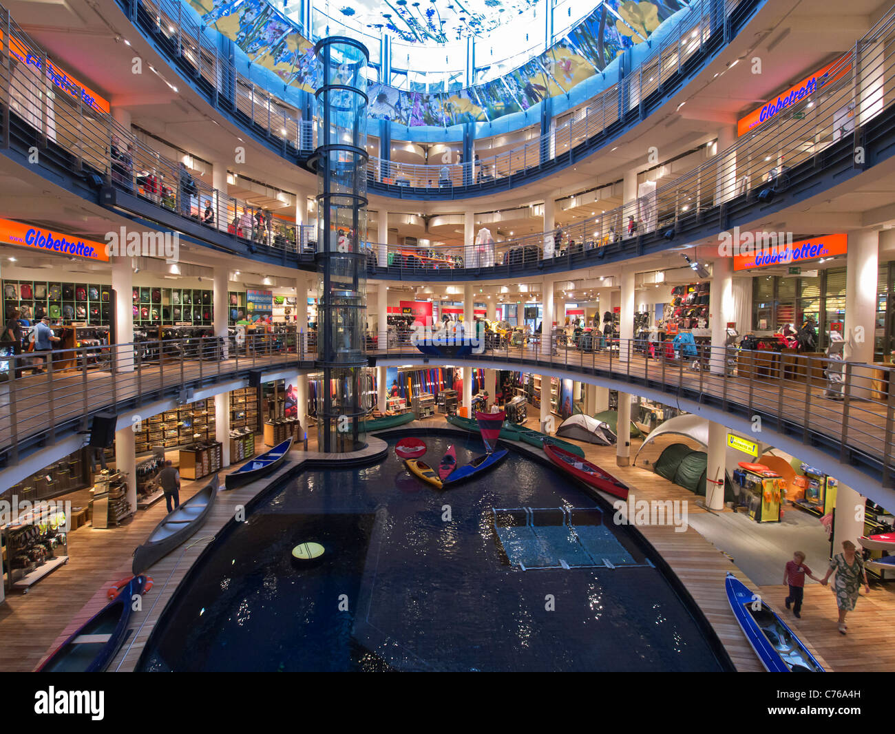 large atrium with pool for testing canoes and kayaks in globetrotter stock photo royalty free. Black Bedroom Furniture Sets. Home Design Ideas