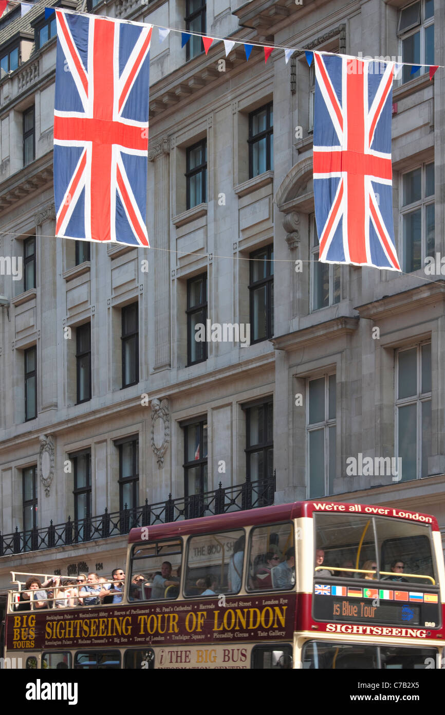 Union Jack Flags and Sightseeing Bus on Regent Street; London Stock ...