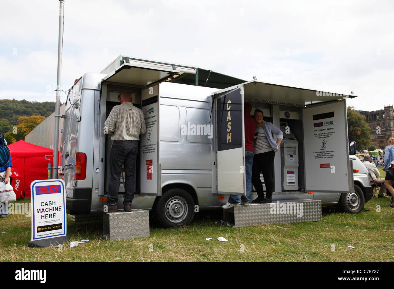 cash on the move mobile atm machines at an outdoor event. Black Bedroom Furniture Sets. Home Design Ideas