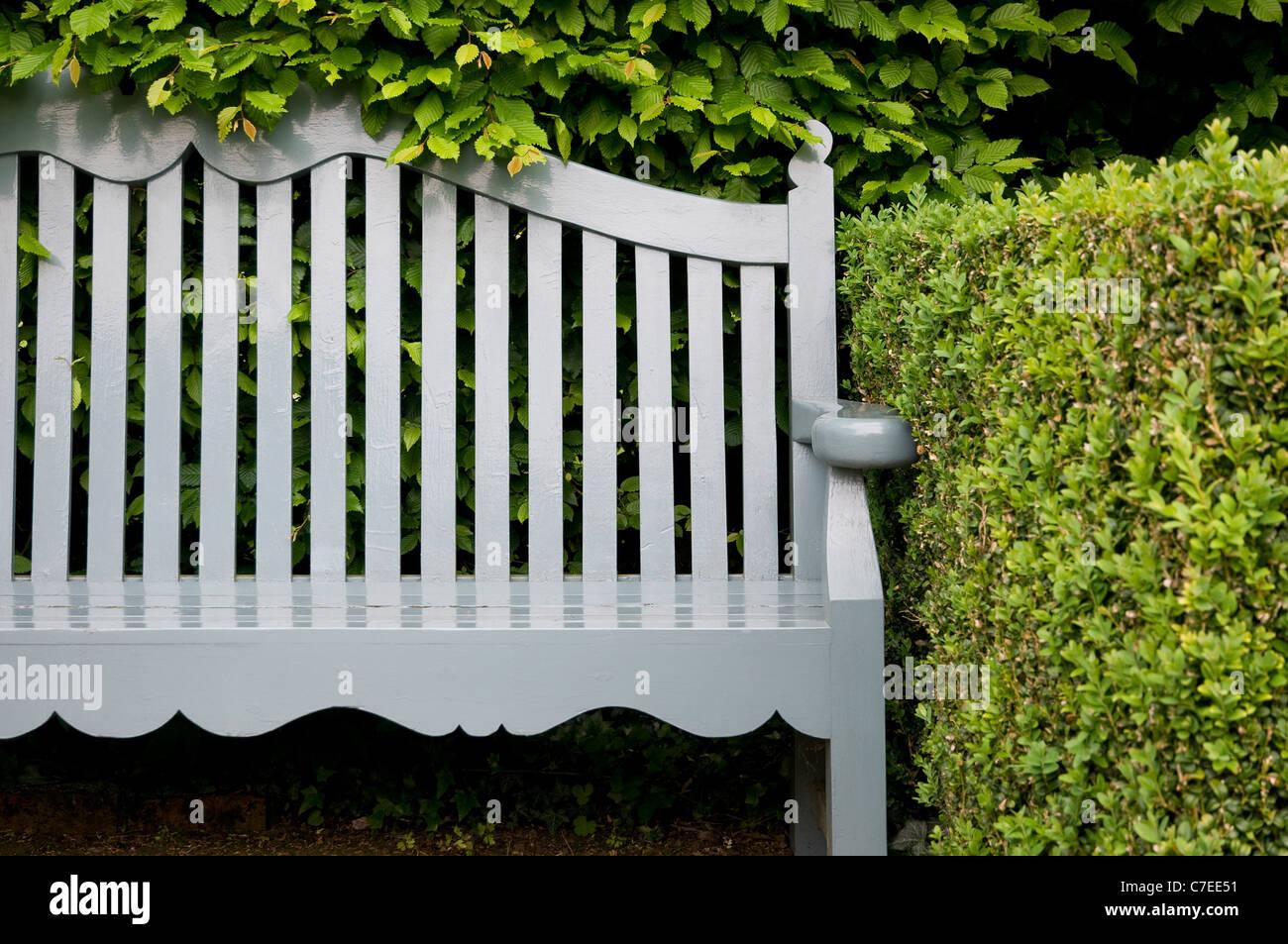 Grey Painted Garden Bench Norfolk England Stock Photo