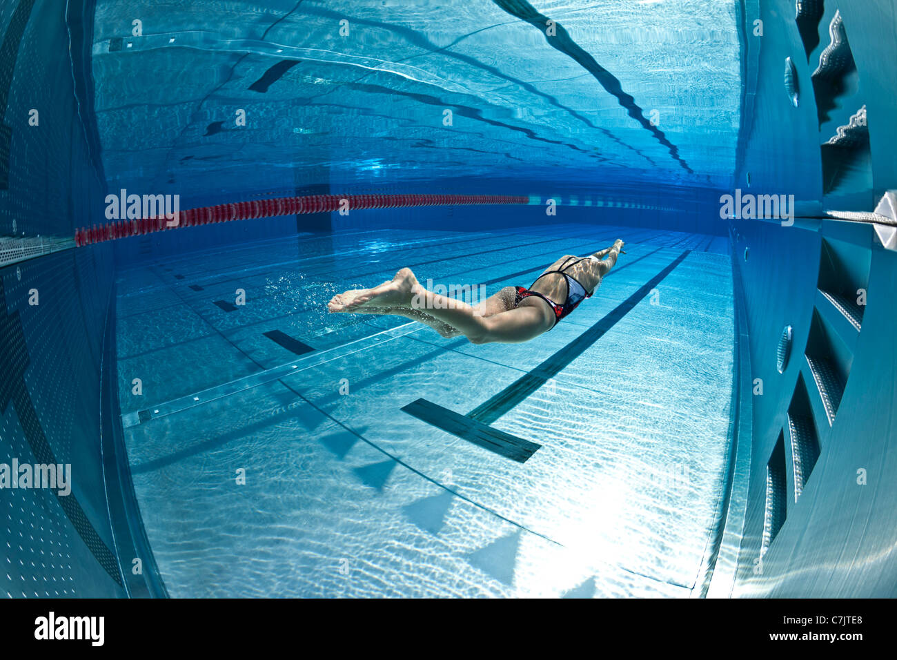 Olympic Swimming Pool Underwater a female swimmer training in an open air olympic pool (france