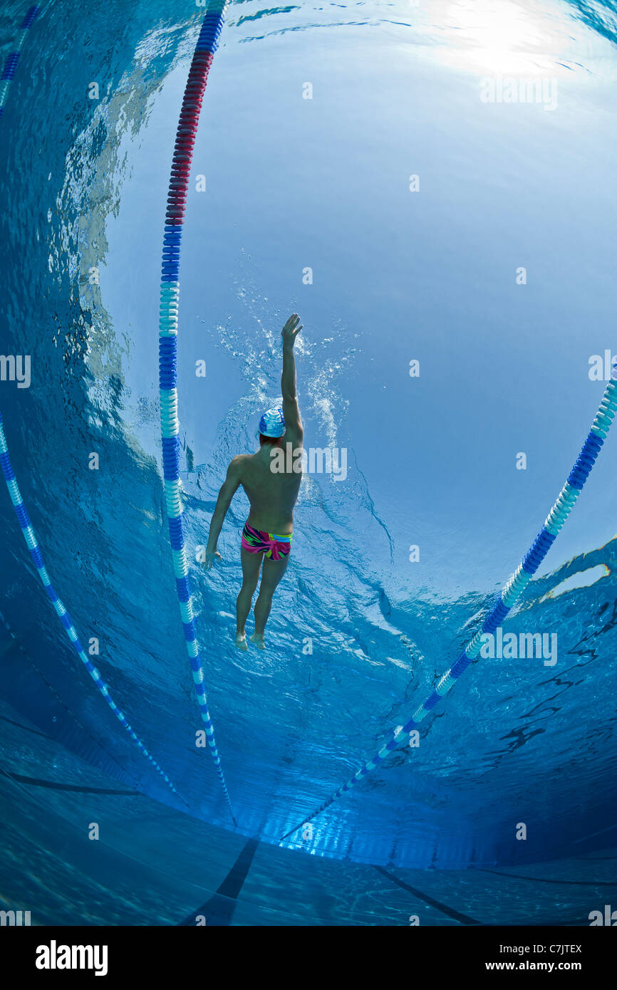 a male swimmer training in an open air olympic swimming pool france underwater view