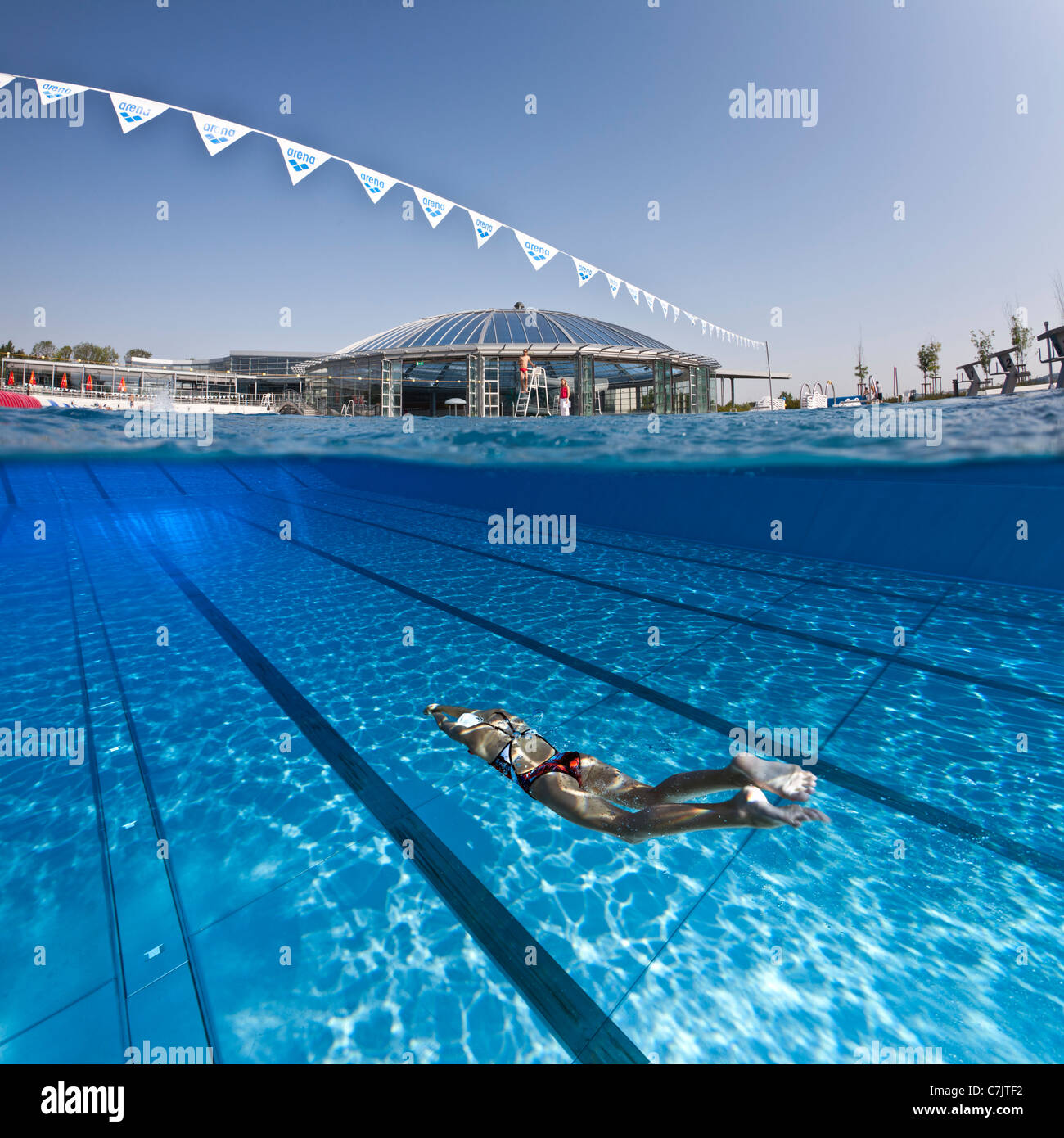 a female swimmer training in an open air olympic swimming pool france underwater view - Olympic Swimming Pool Underwater