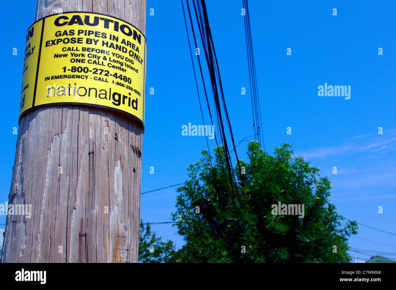 National grid caution sign on electrical power pole on new york national grid caution sign on electrical power pole on new york city borough street usa biocorpaavc Image collections