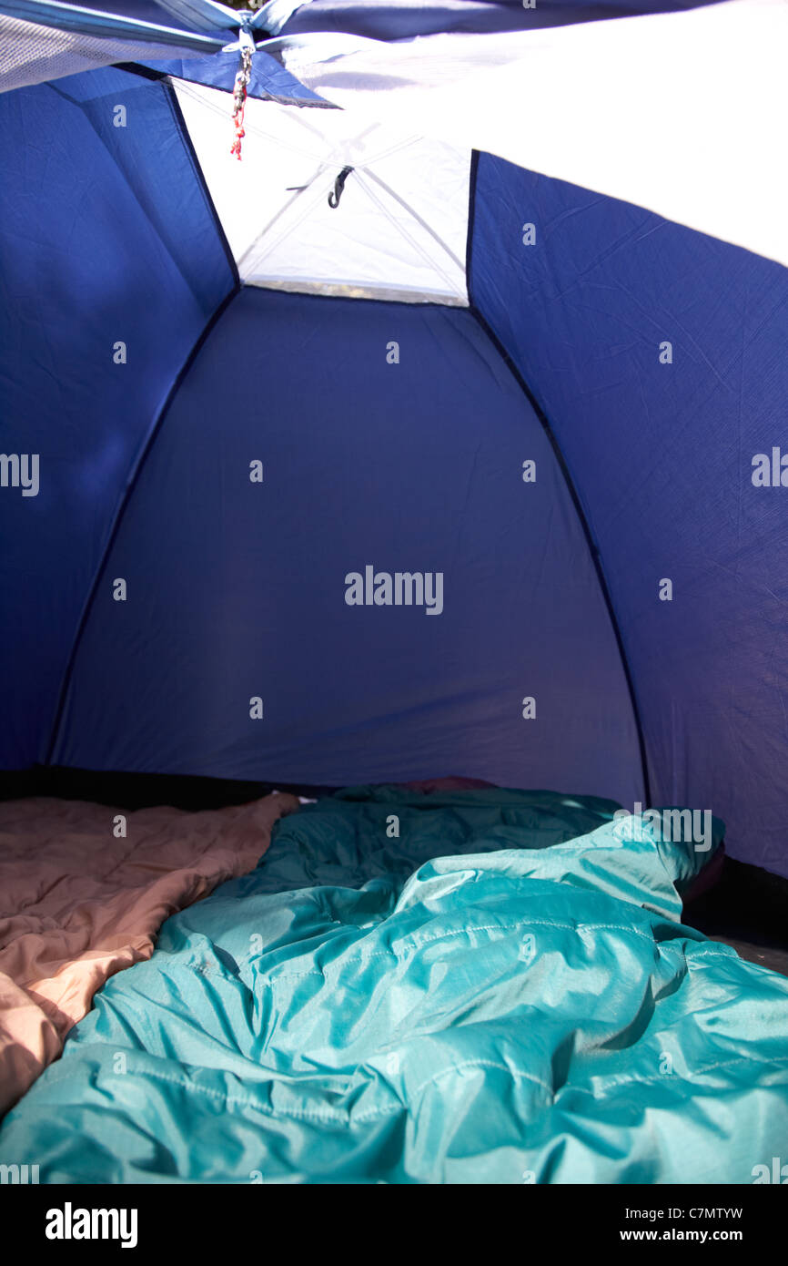 two sleeping bags laying out inside a small dome tent & two sleeping bags laying out inside a small dome tent Stock Photo ...