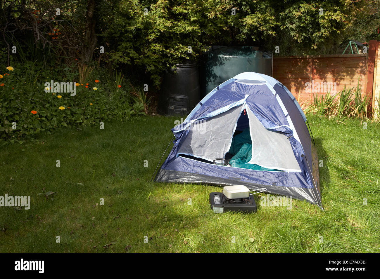 front door left open on a small dome tent pitched in the garden of the house in the uk & front door left open on a small dome tent pitched in the garden of ...