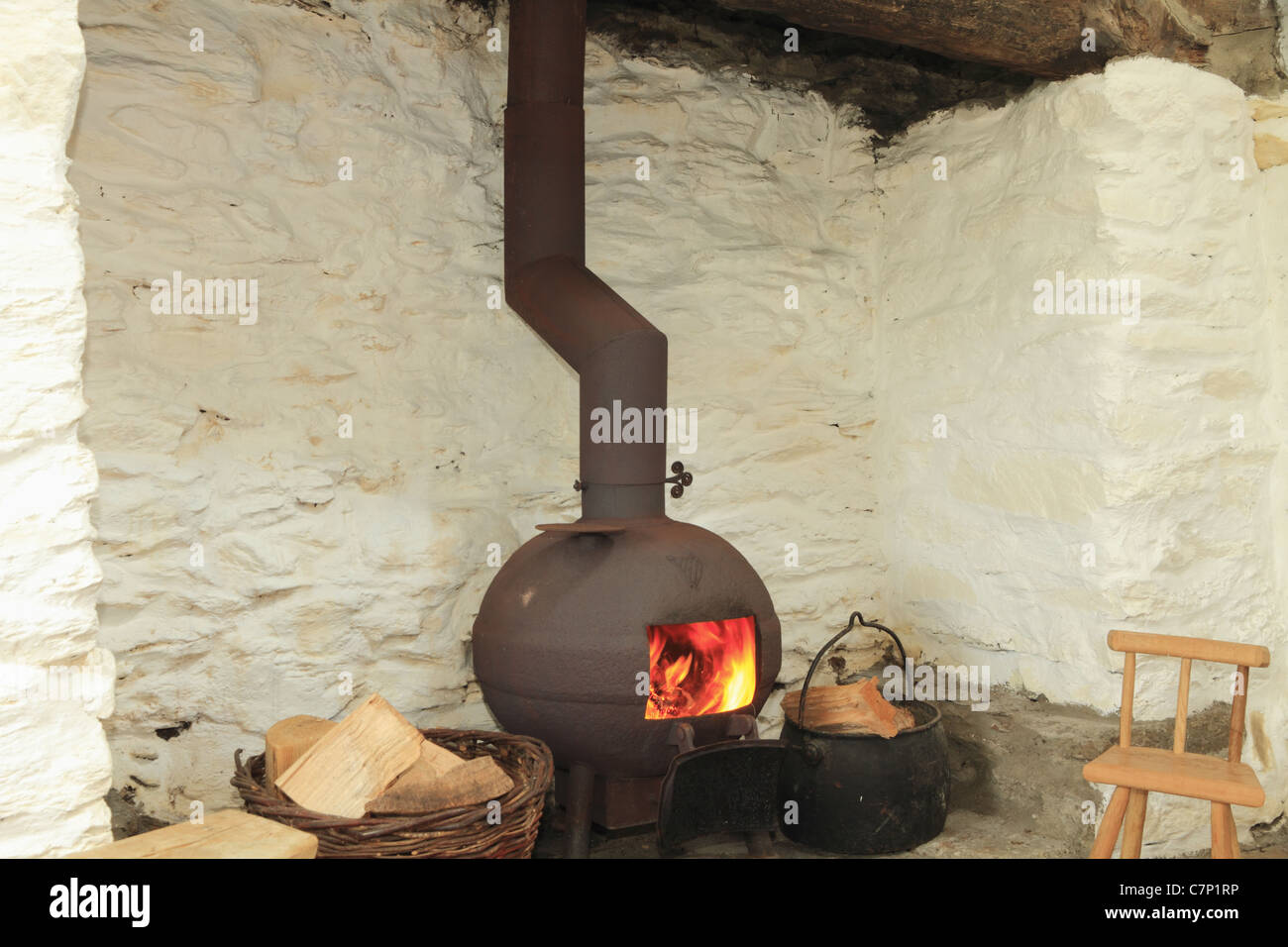 A Pot Bellied Stove In A Traditional Irish Fireplace County Kerry Stock Photo Royalty Free