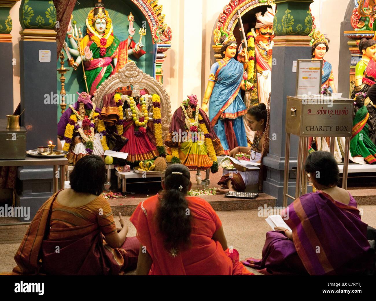 Hindu Worshippers And Deities Inside The Sri Mariamman ...