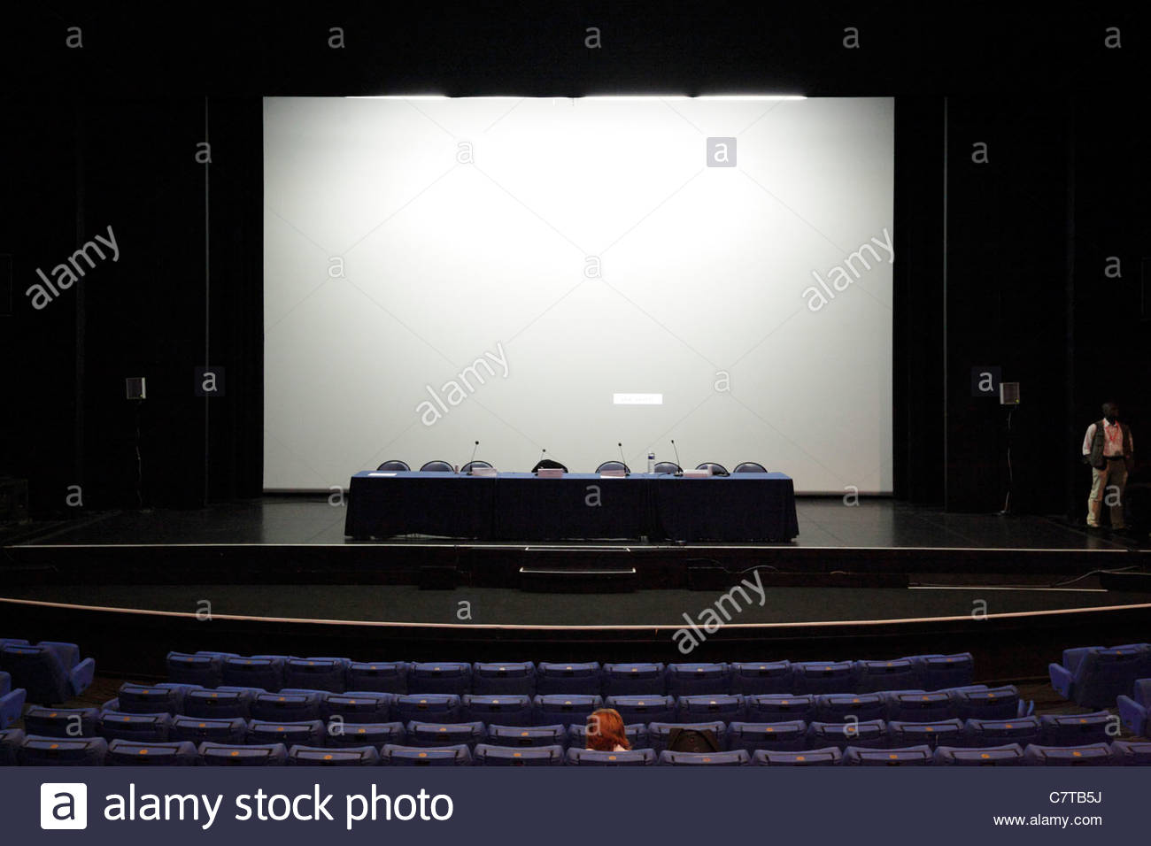 stock photo large blank projection screen and empty stage in a conference hall