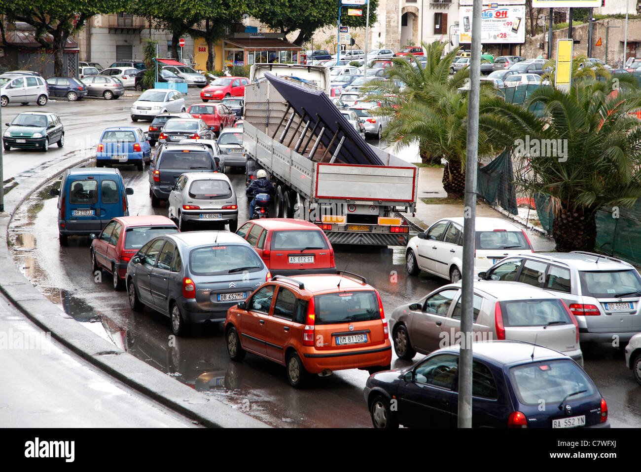 road with traffic jam cars and trucks on a rainy day palermo stock photo royalty free image. Black Bedroom Furniture Sets. Home Design Ideas