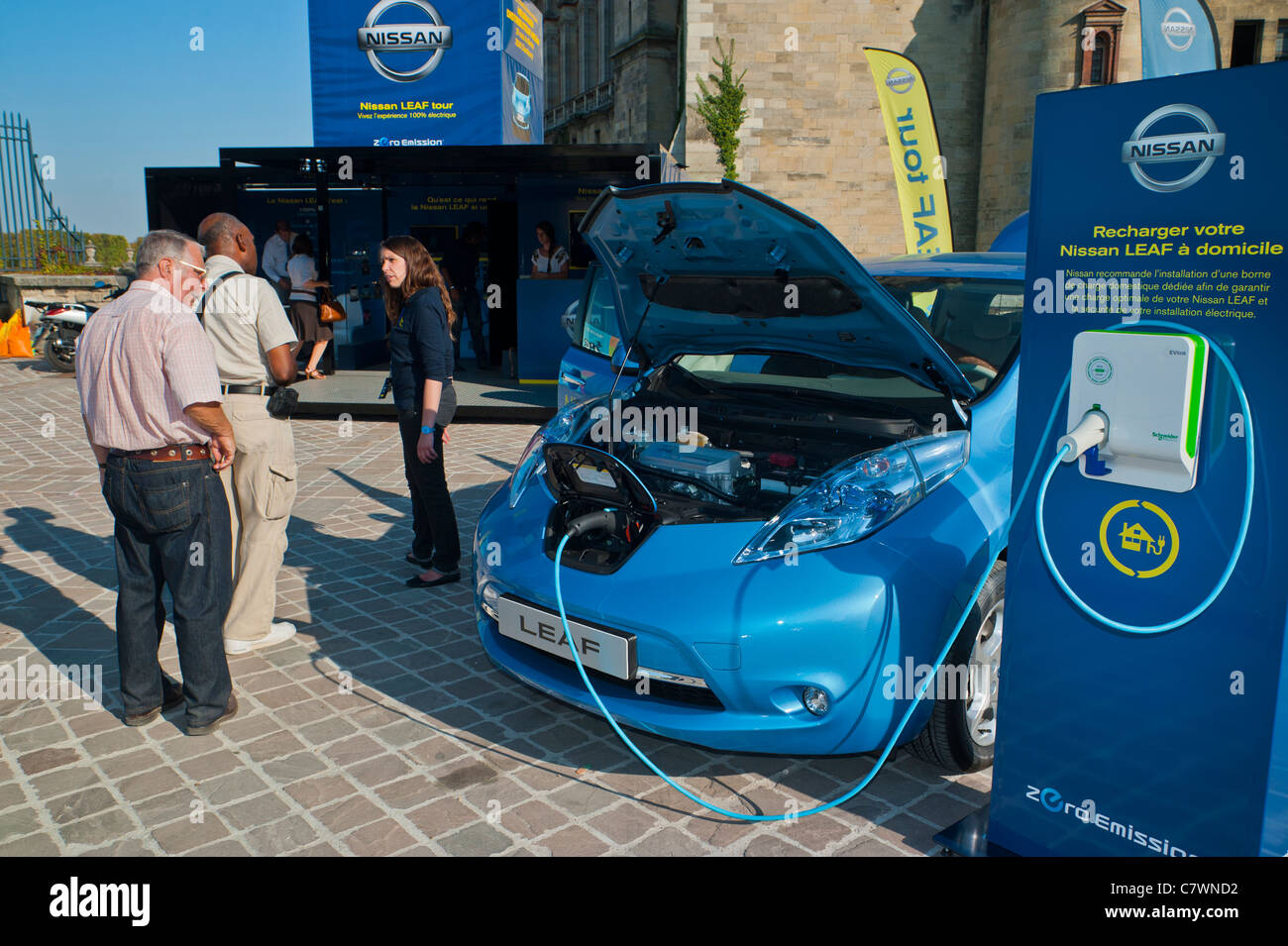 Paris france battery charger home unit nissan leaf electric car on display in saint germain en laye