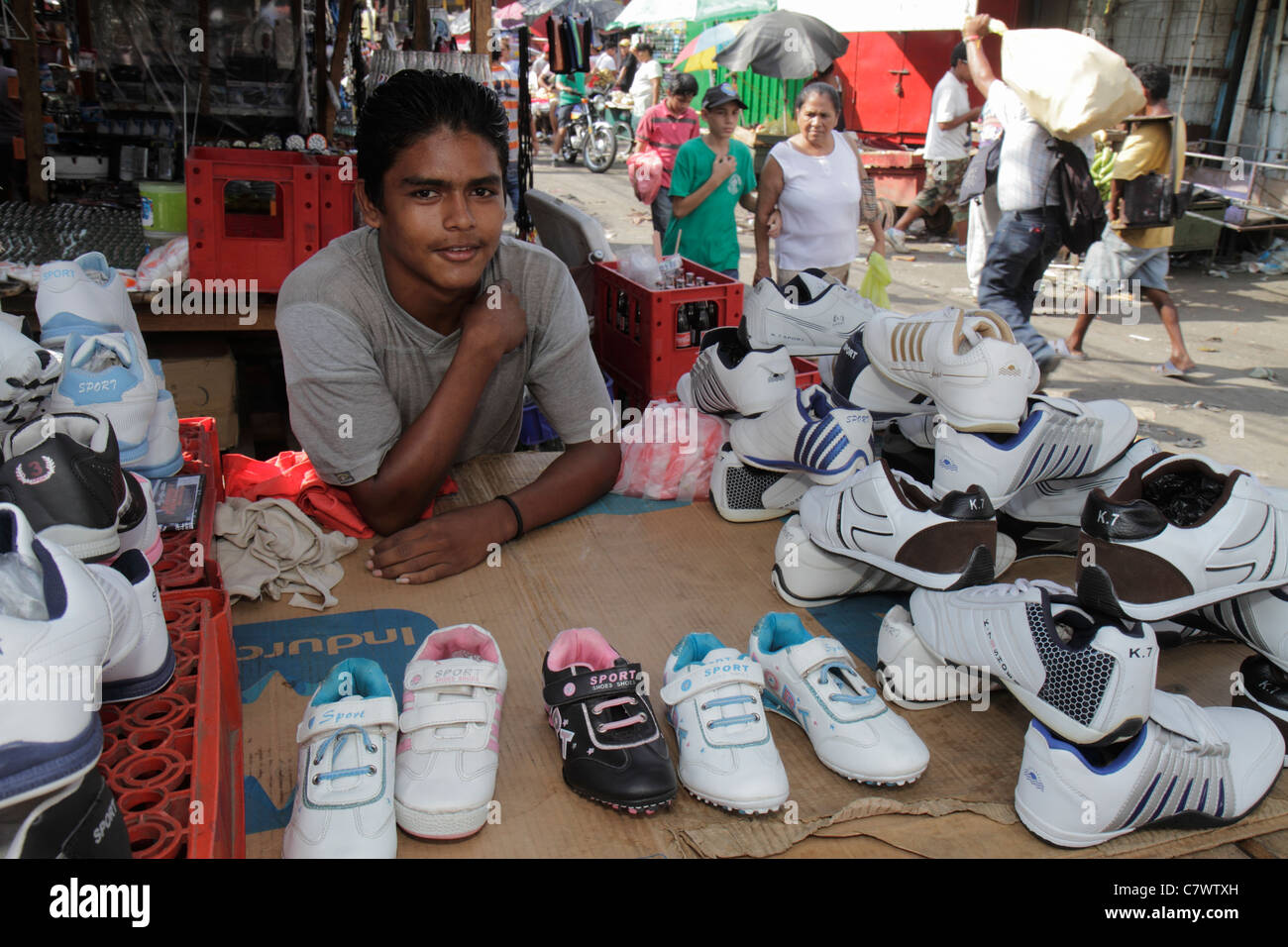 managua mercado oriental flea market marketplace managua mercado oriental flea market marketplace shopping shopper vendor stall hispanic boy teen job athletic