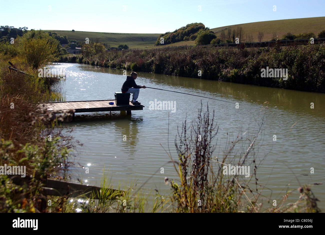 Angling at passies pond near lancing west sussex uk stock for Stocked fishing ponds near me