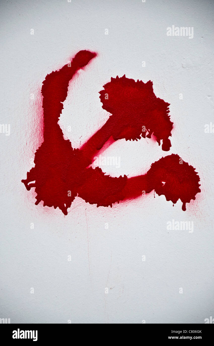 Hammer and sickle symbol painted on bridge in roma italy stock communist symbol of hammer and sickle spray painted on a white wall stock photo biocorpaavc Gallery