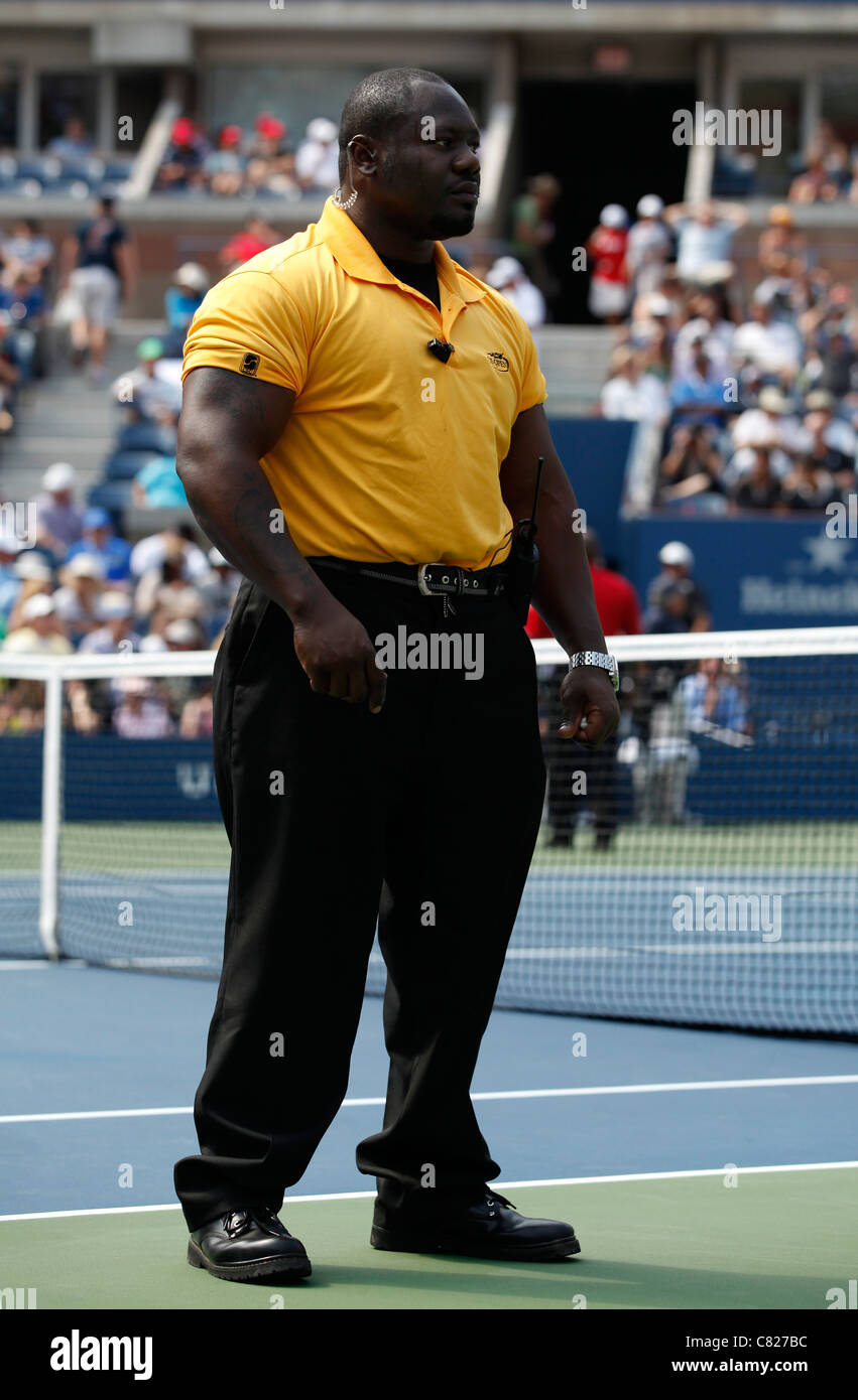 Plug Stock News >> Security guard standing on the Centre Court at the 2011 US ...