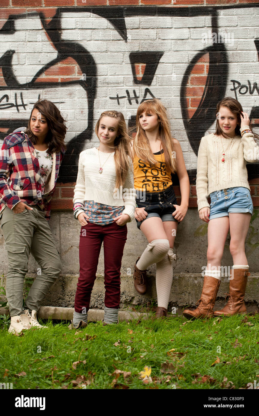 13 Year Old Girl: A Group Of 13 Year Old Teenage Girls Moody With Attitude