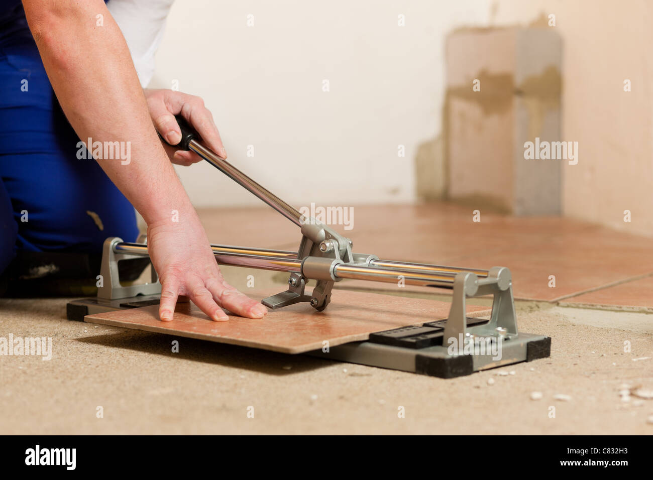Construction worker is cutting tiles at home stock photo 39405887 construction worker is cutting tiles at home dailygadgetfo Images