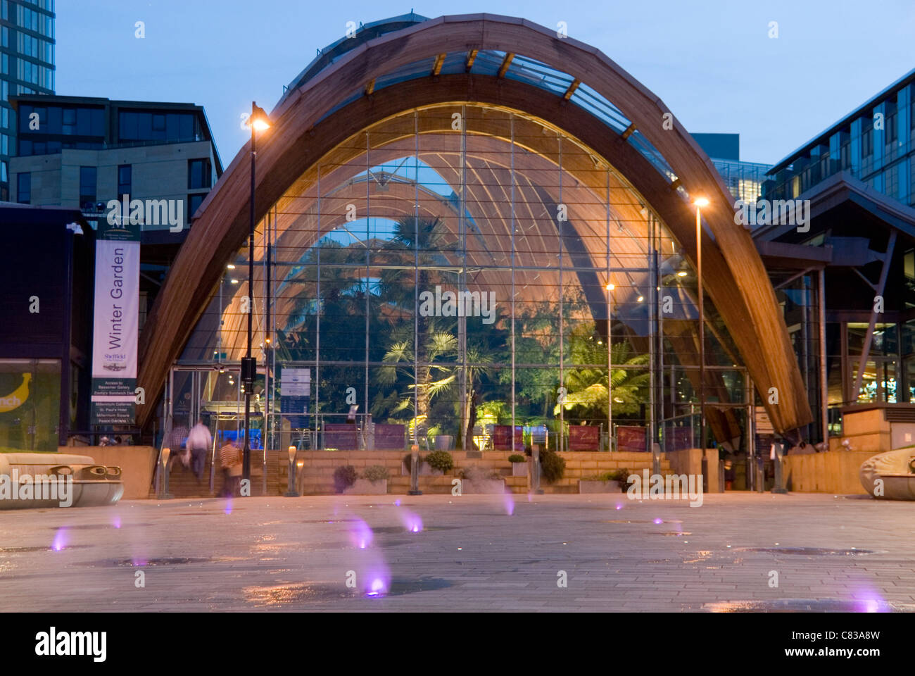 entrance to winter gardens at night with colourful steam jets of