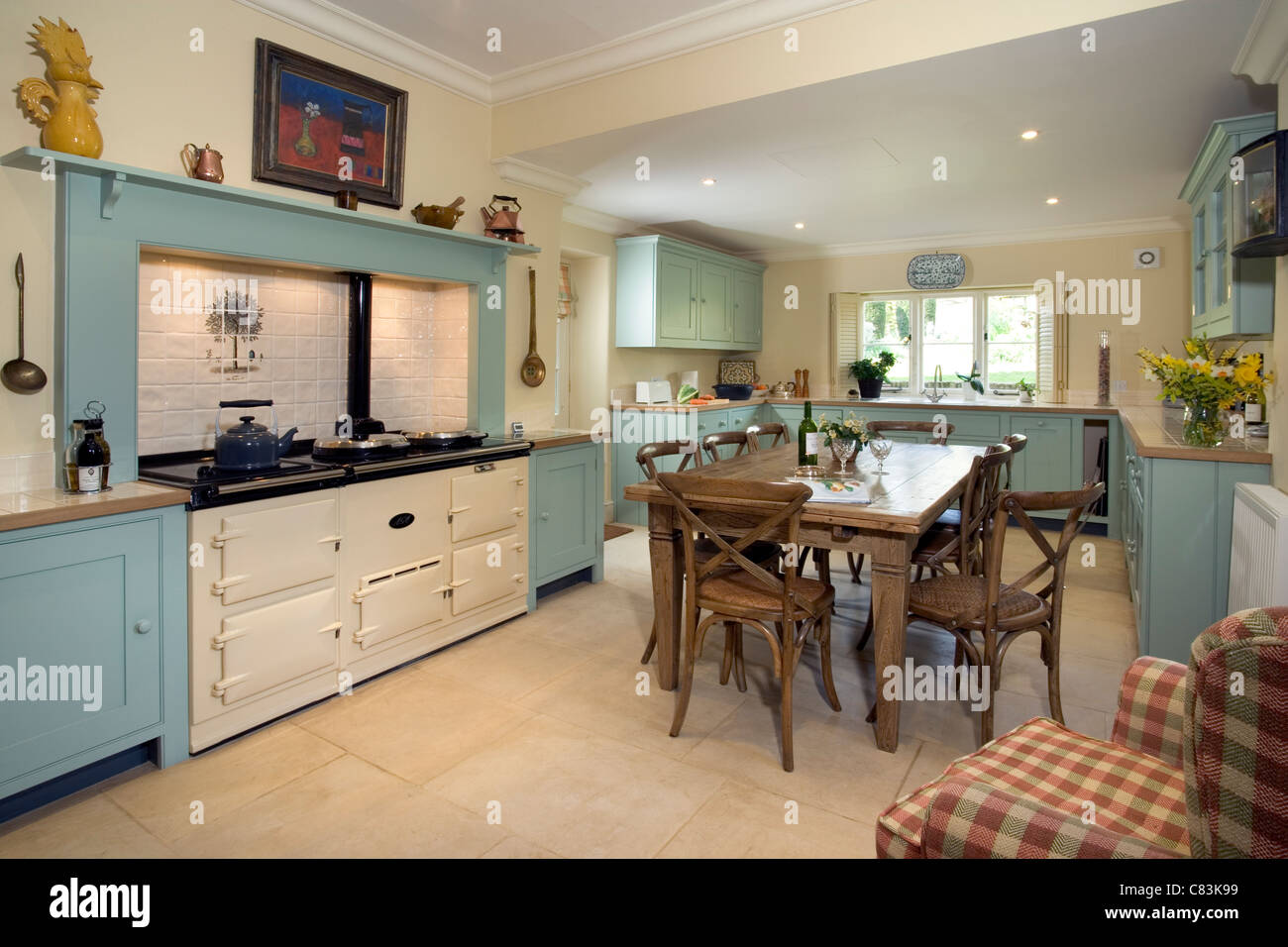 contemporary farmhouse style kitchen with aga cooker stock photo