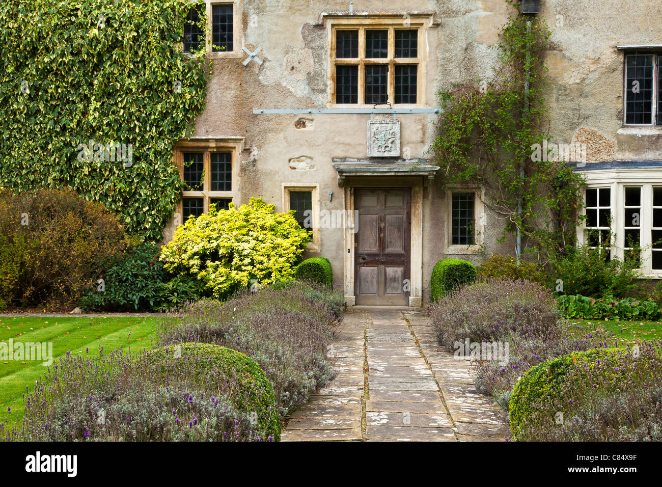 The front door and facade of an early 16th century English manor house at  Avebury in Wiltshire, England, UK