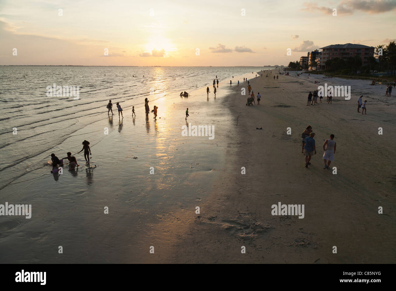 People at the beach at sunset fort myers beach florida usa people at the beach at sunset fort myers beach florida usa geenschuldenfo Gallery
