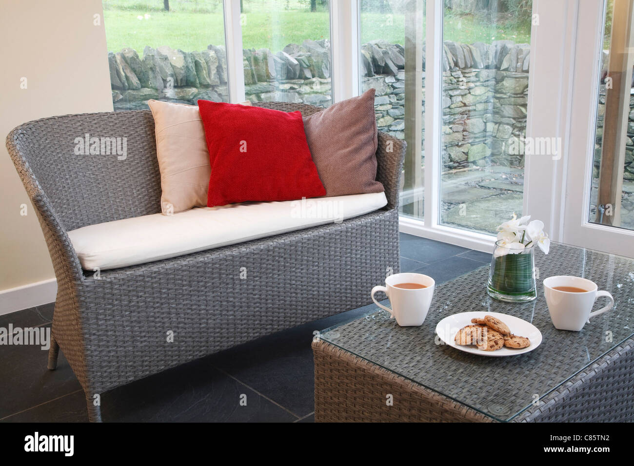 Conservatory interior design with rattan chairs and coffee table conservatory interior design with rattan chairs and coffee table geotapseo Image collections