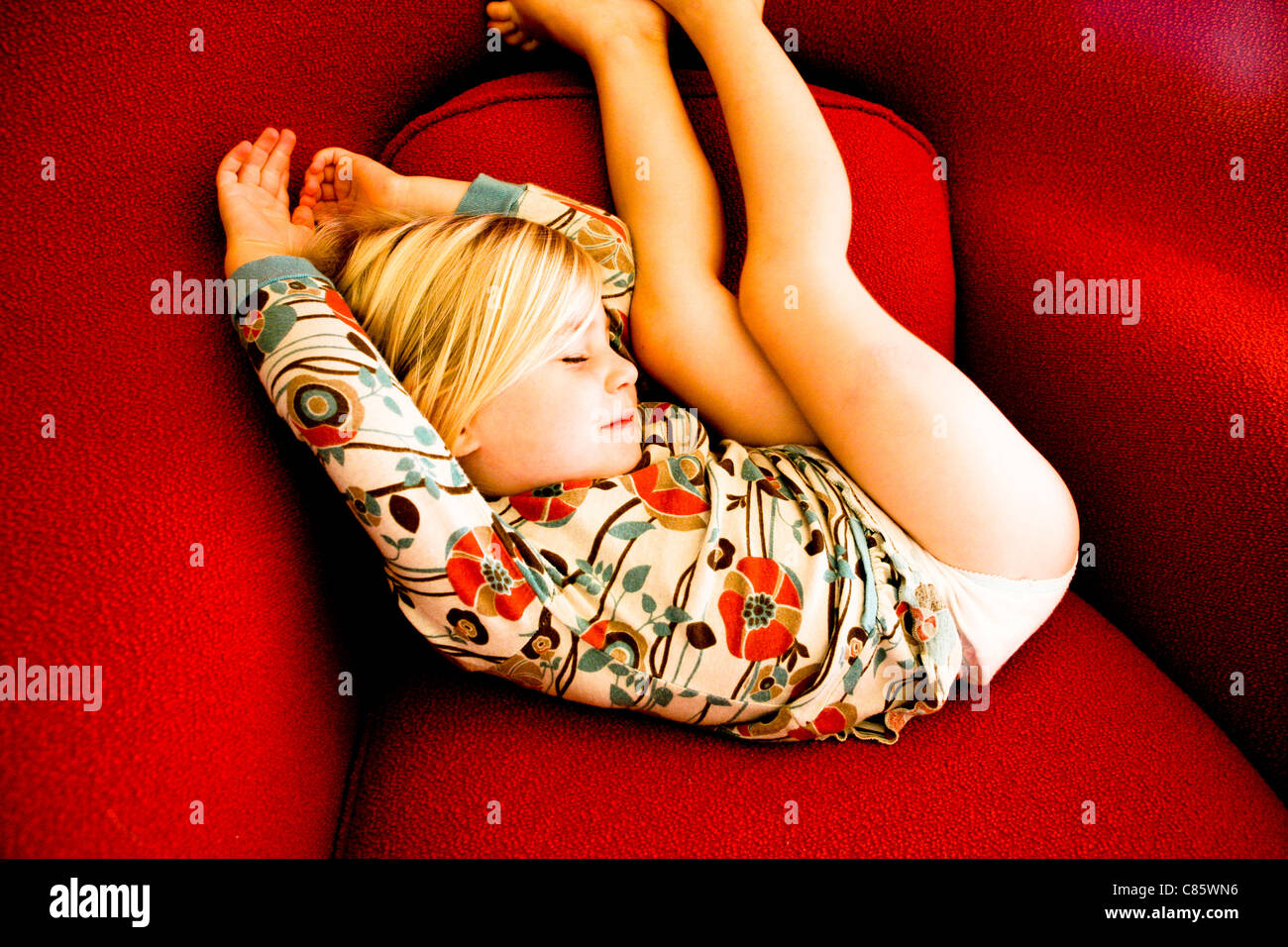 Red chair photography - Little Girl Sleeping Curled Up On A Red Chair