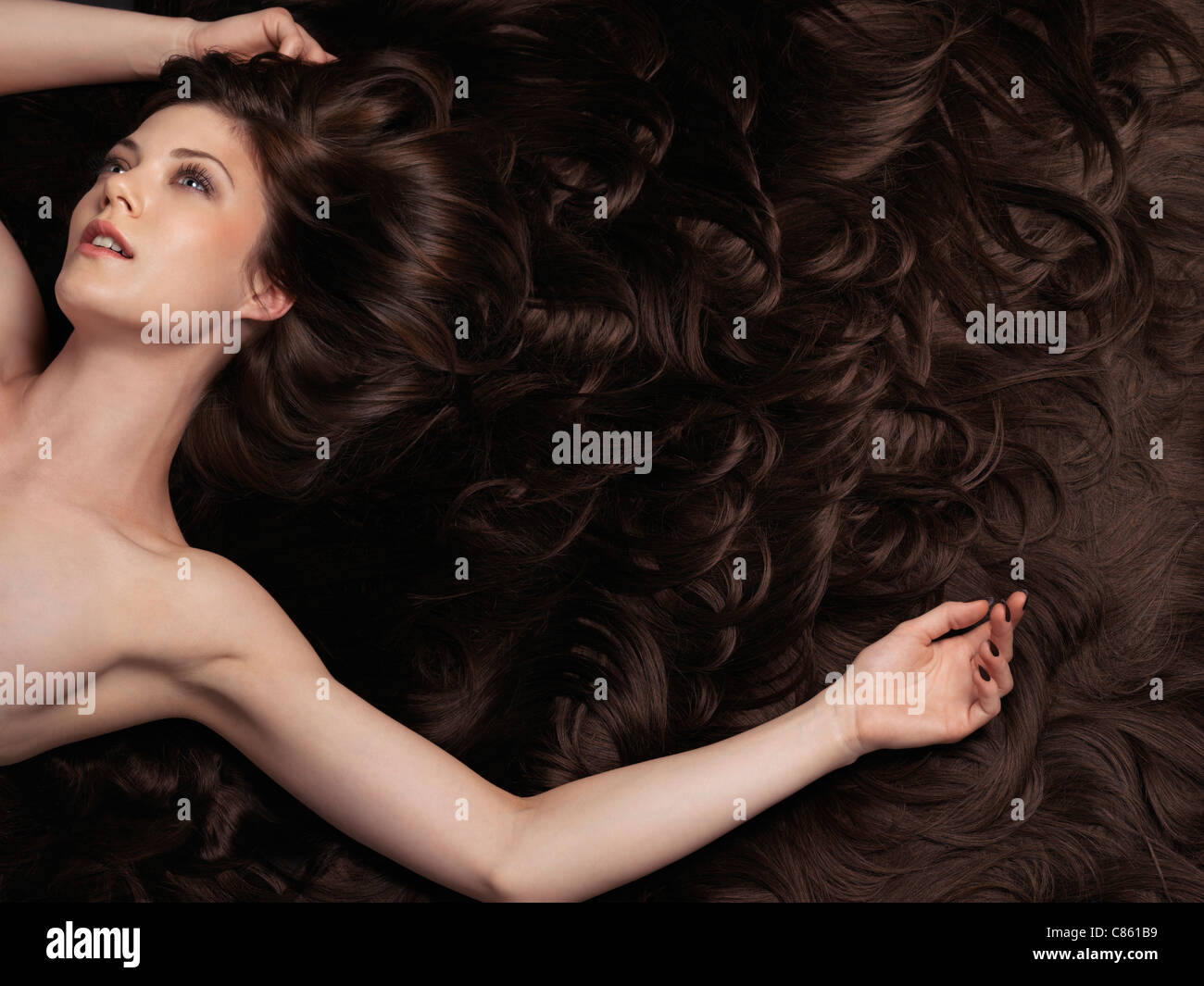 Beautiful woman with very long brown hair and hair extensions beautiful woman with very long brown hair and hair extensions large copyspace or background pmusecretfo Choice Image