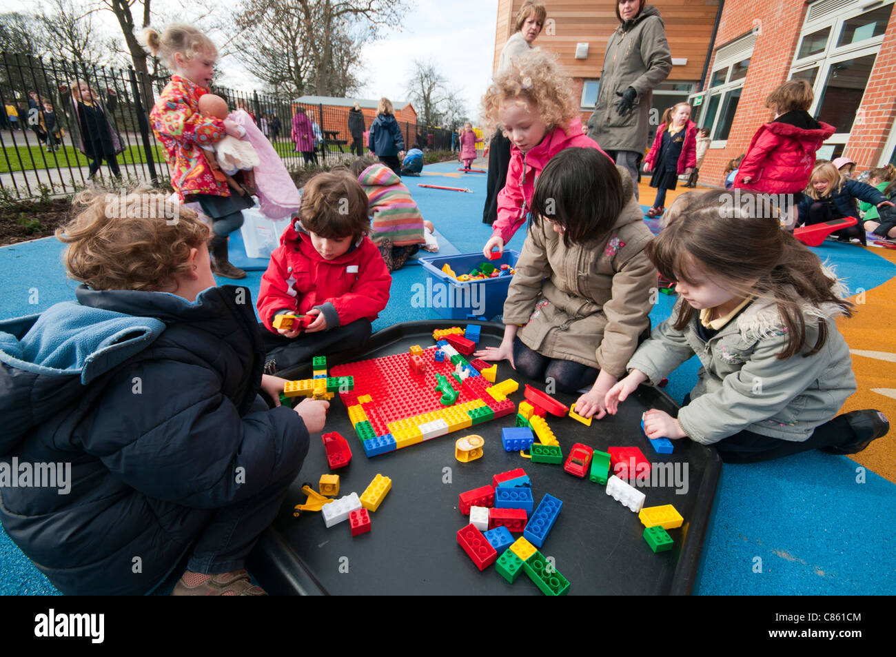 young primary school children playing with building blocks - Images Of Children Playing At School