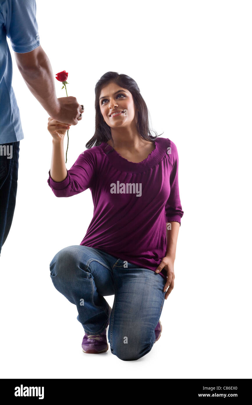 Girl proposing to her boyfriend stock photo royalty free - Boy propose girl with rose image ...