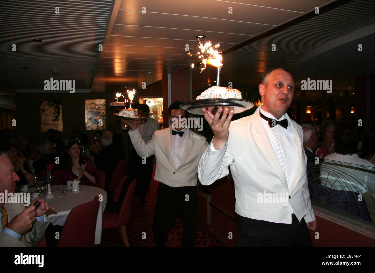 Waiter With Baked Alaska And Sparkler Captains Dinner Aboard A - What to wear on a cruise ship dinner