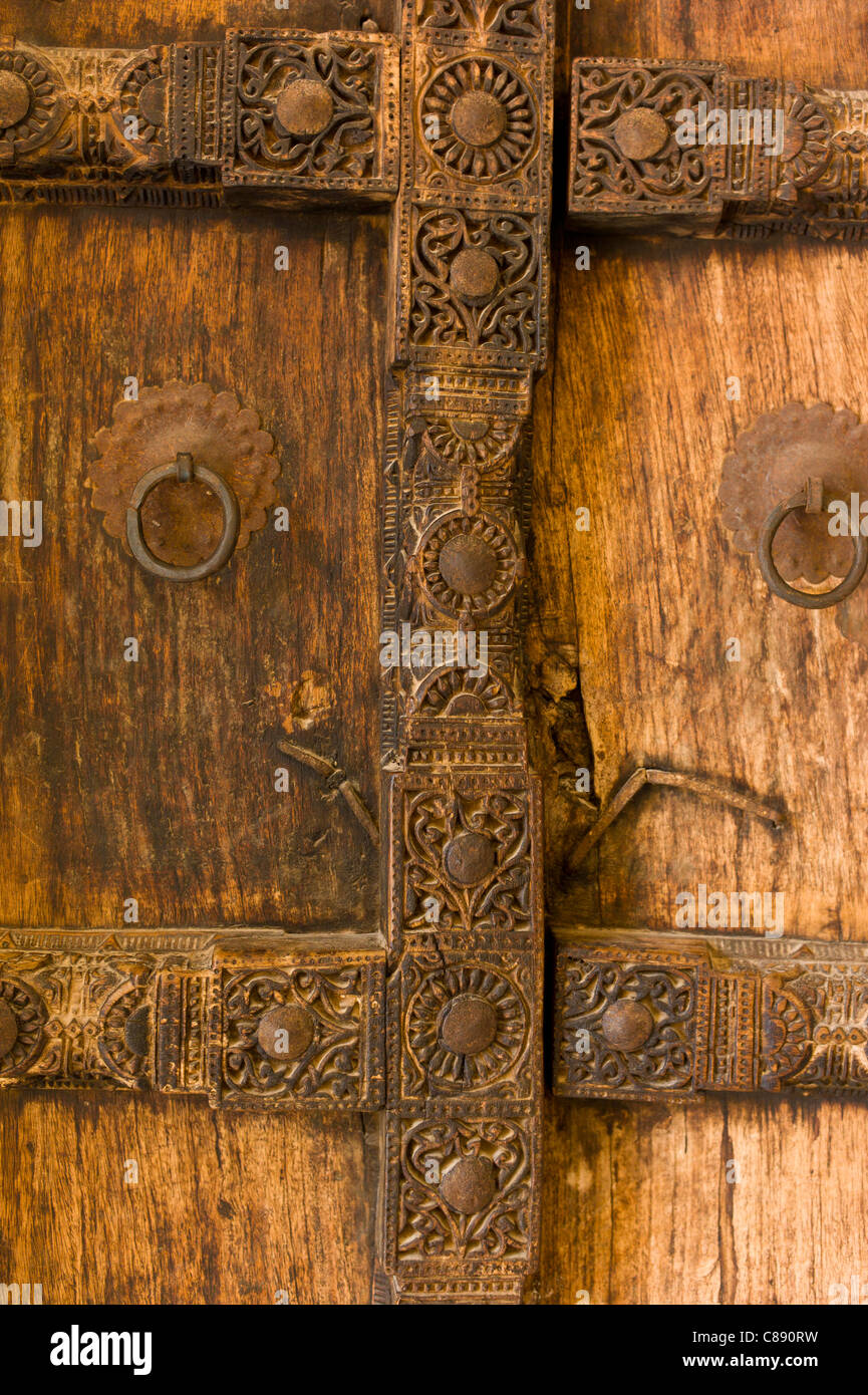 Hindu style traditional door in Acacia wood at the 16th Century Amber Fort in Jaipur in Rajasthan Northern India & Hindu style traditional door in Acacia wood at the 16th Century ...