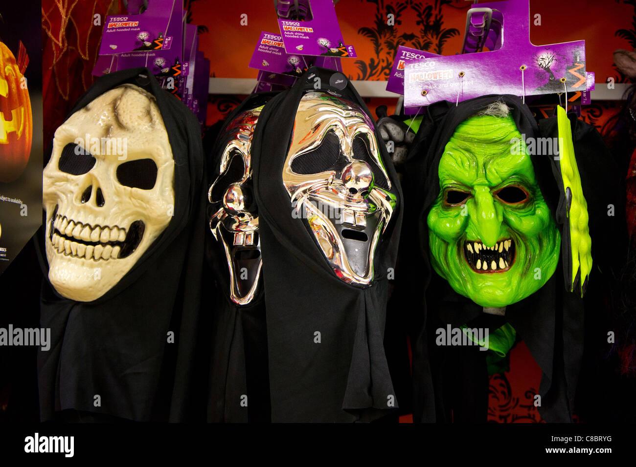Halloween masks on sale in tesco supermarket, uk Stock Photo ...