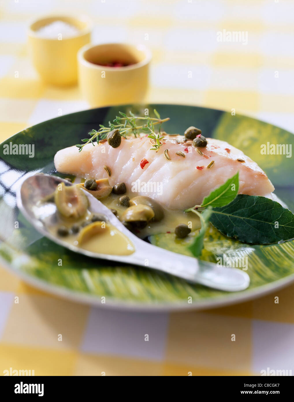 Steam cooked piece of cod with aromatic herbs stock photo for Aromatic herb for fish