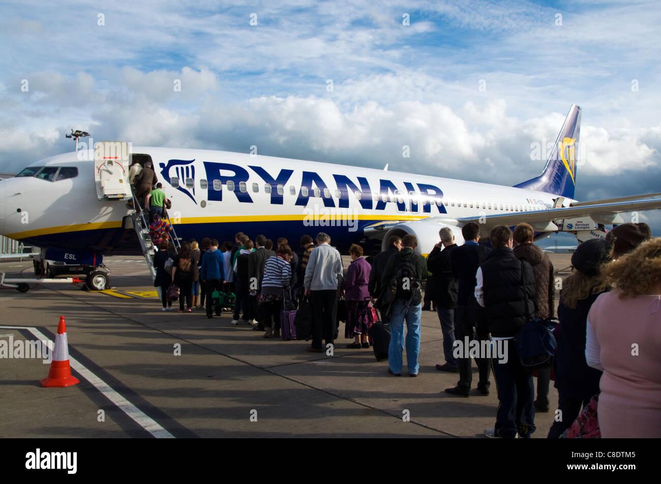 Passengers Queue To Board A Ryanair Boeing 737800 Plane