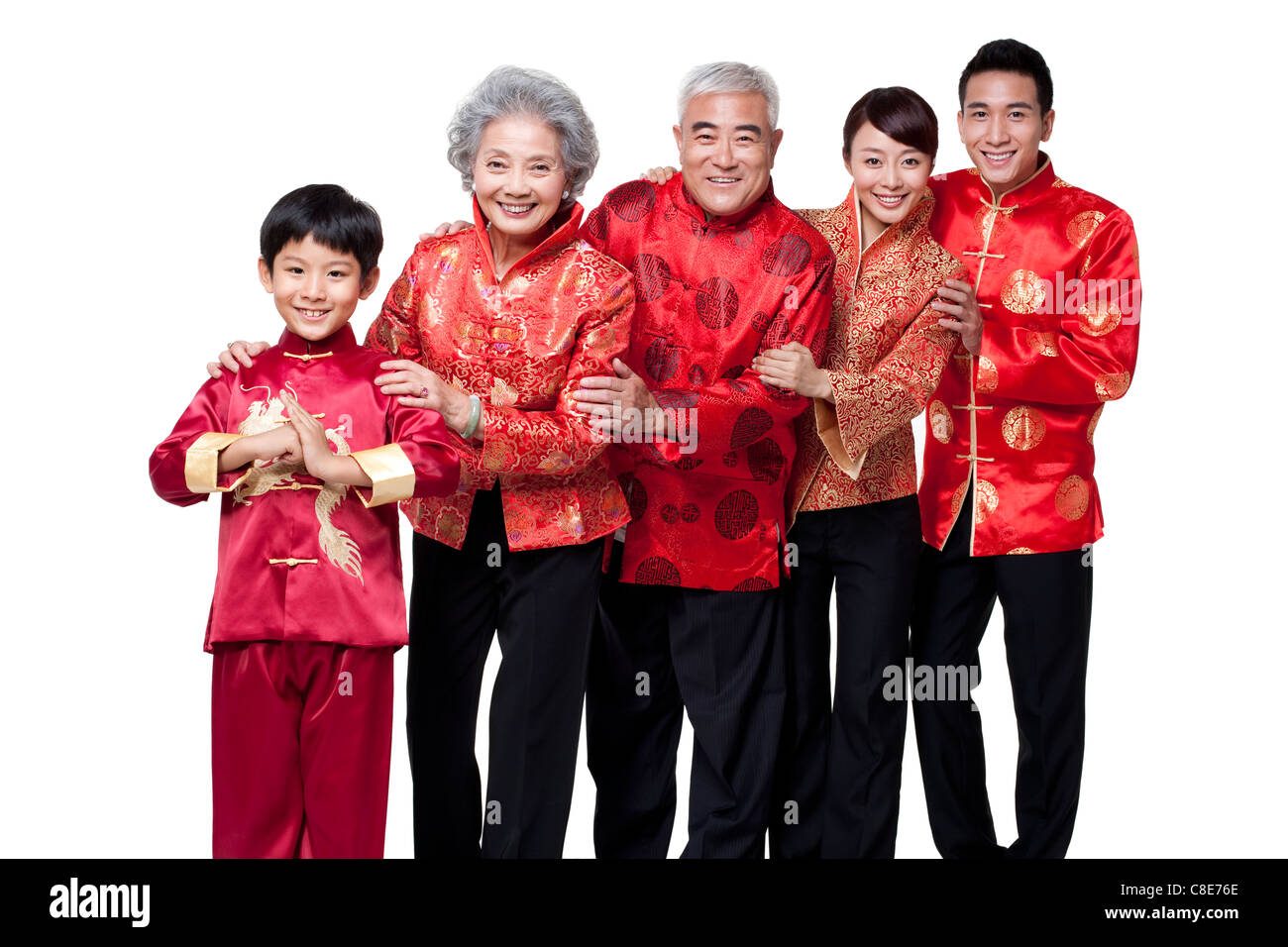 Family dressed in traditional clothing celebrating chinese for Traditional photos