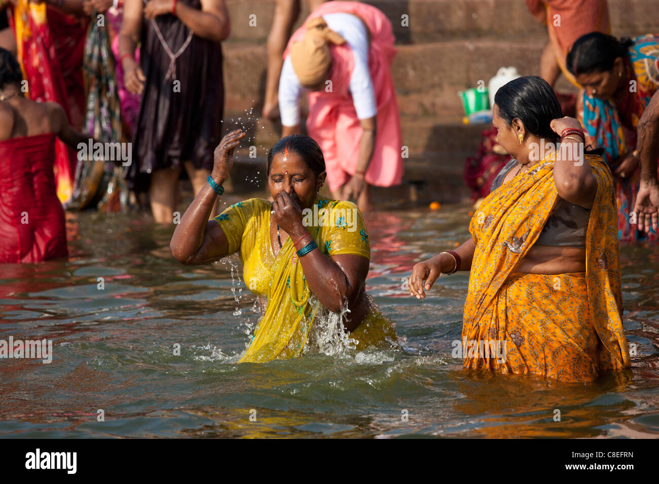 Indian Hindu Pilgrims Bathing In The Ganges River At