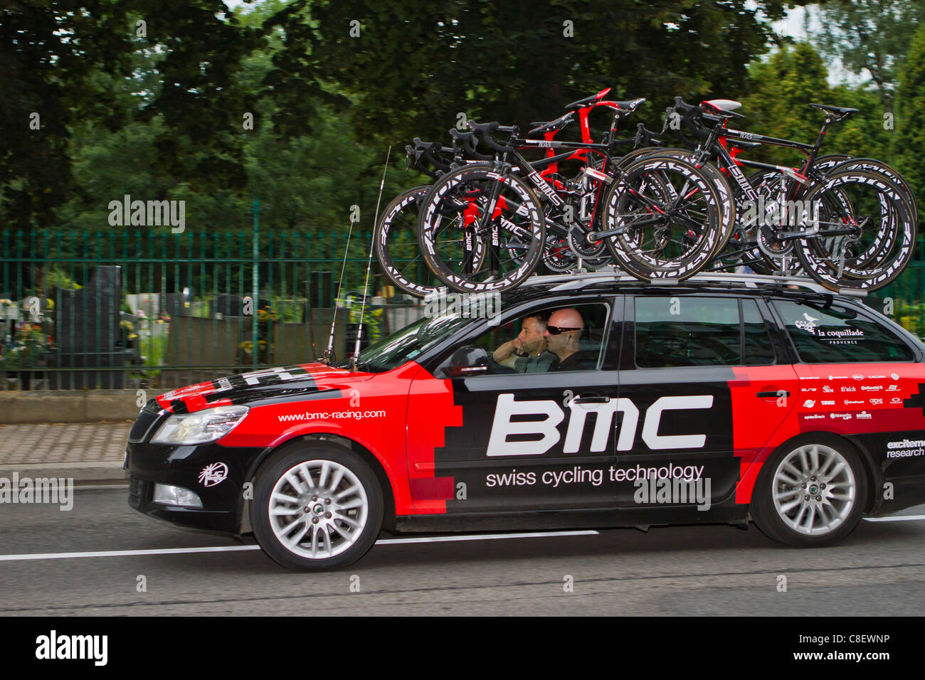 Bike Racing Team Car With Spare Bicycles On The Roof Rack Tour