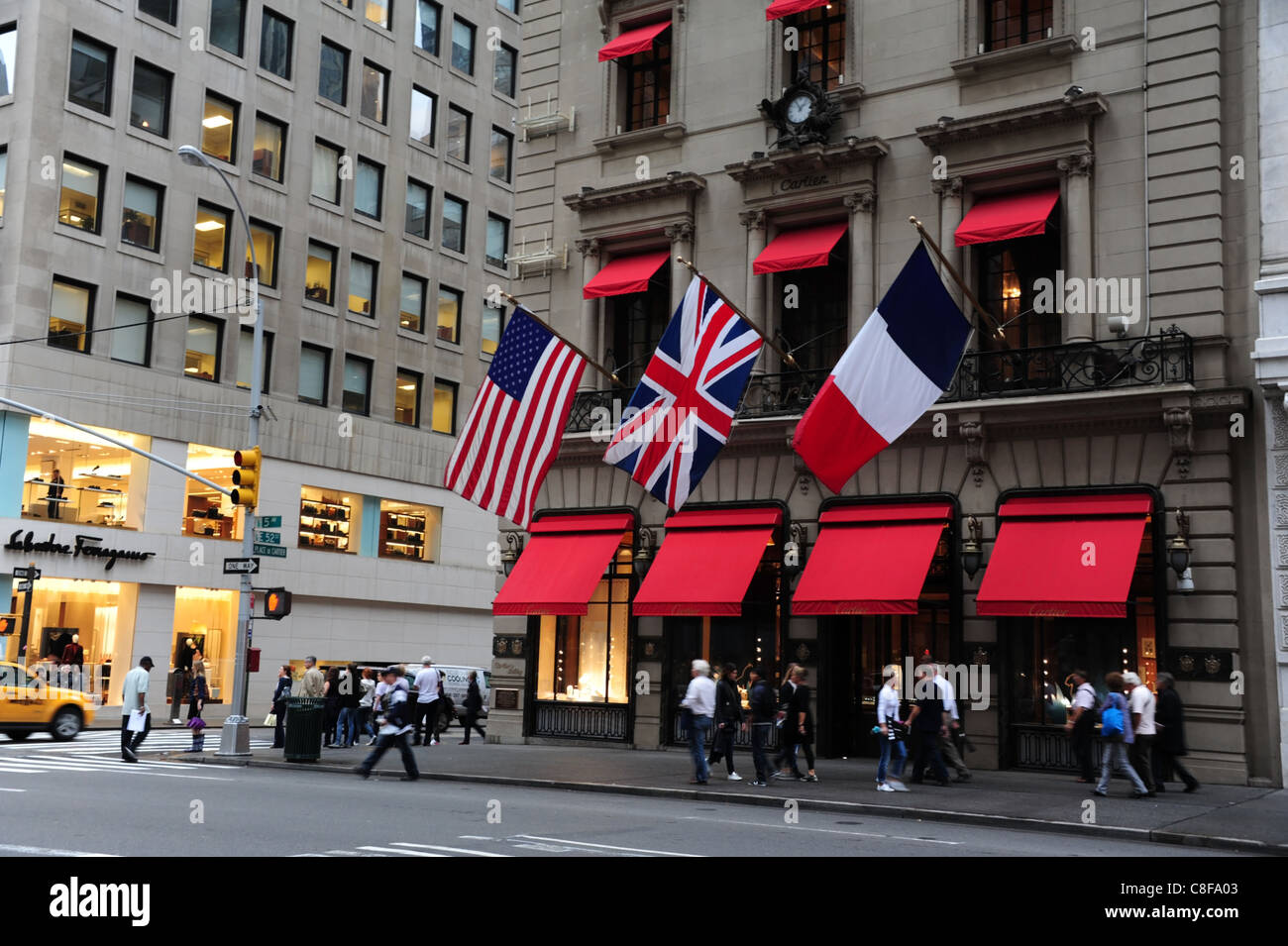 People walking front red canopy windows American French Union Flags Cartier Store 5th Avenue East 52nd Street New York & People walking front red canopy windows American French Union ...