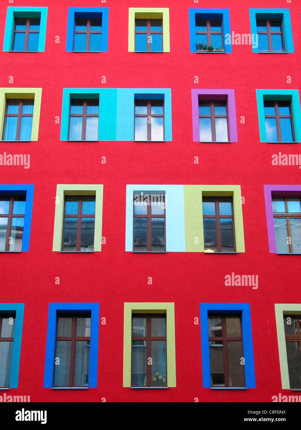 Red house wall coloured window frames berlin germany windows