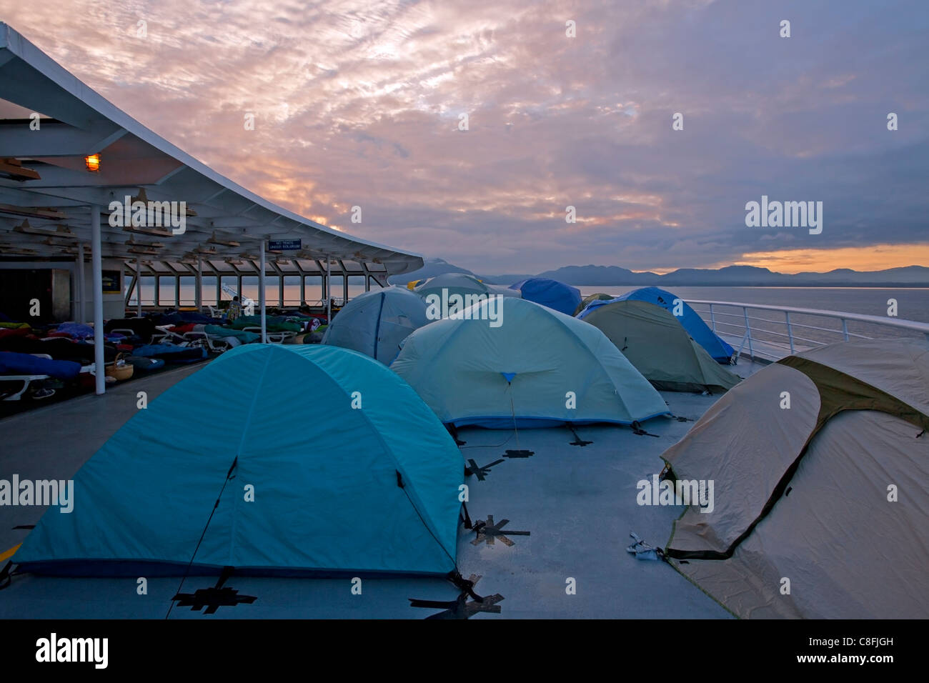 Tents on the deck of the Columbia ferry. Alaska Inside Passage. USA & Tents on the deck of the Columbia ferry. Alaska Inside Passage ...
