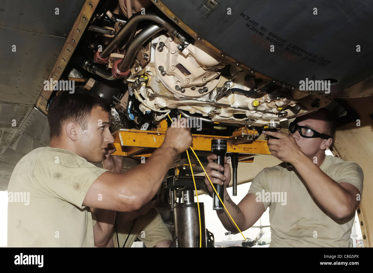 stock photo jet engine mechanic change a constant speed drive on a b 1b lancer turbine engine mechanic