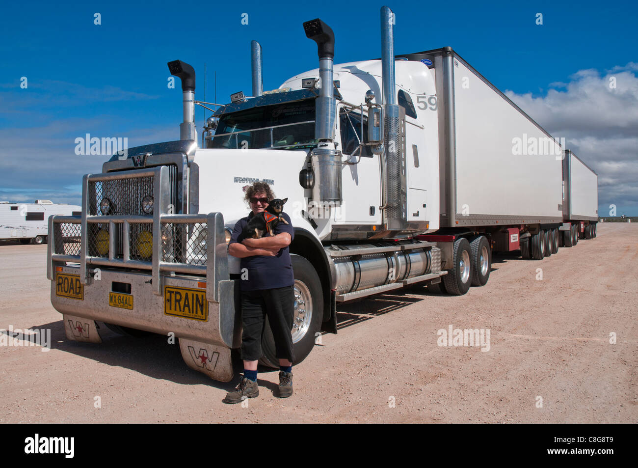 http://c8.alamy.com/comp/C8G8T9/woman-road-train-driver-with-truck-carrying-75-tonnes-of-tomatoes-C8G8T9.jpg