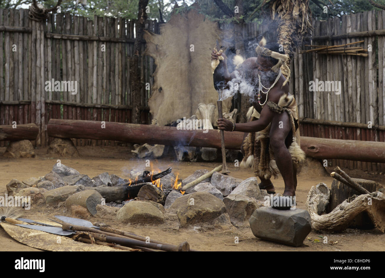 Zulu traditional dress in zulu kraal kwazulu natal - Spear Making Zulu Folk Shakaland Kraal Zululand Kwa Zulu