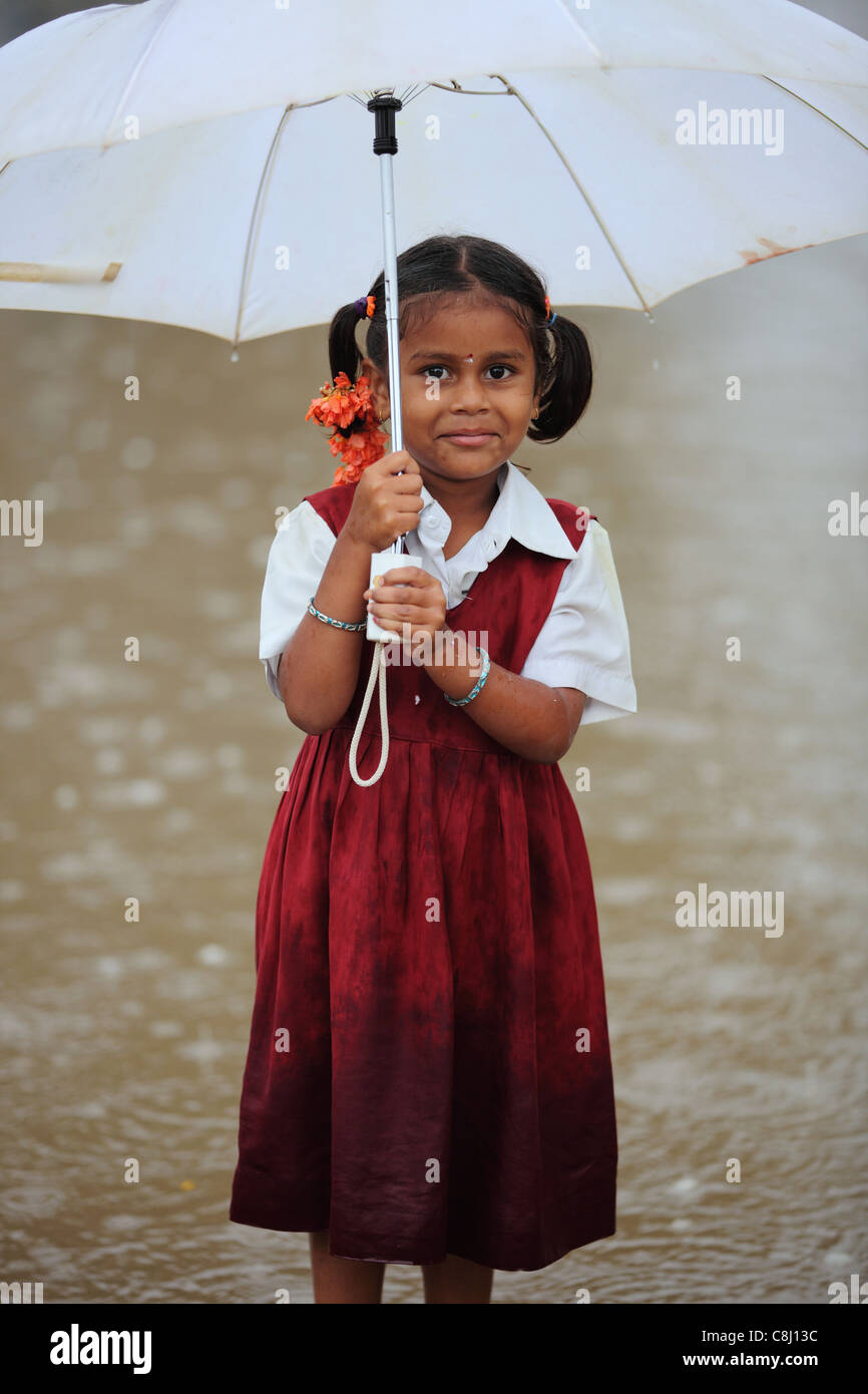 child under the rain with umbrella andhra pradesh south