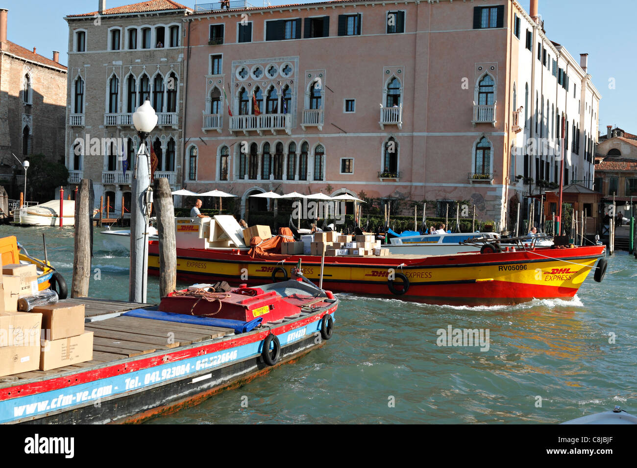dhl express postal boat on the canal grande venice italy stock photo royalty free image. Black Bedroom Furniture Sets. Home Design Ideas