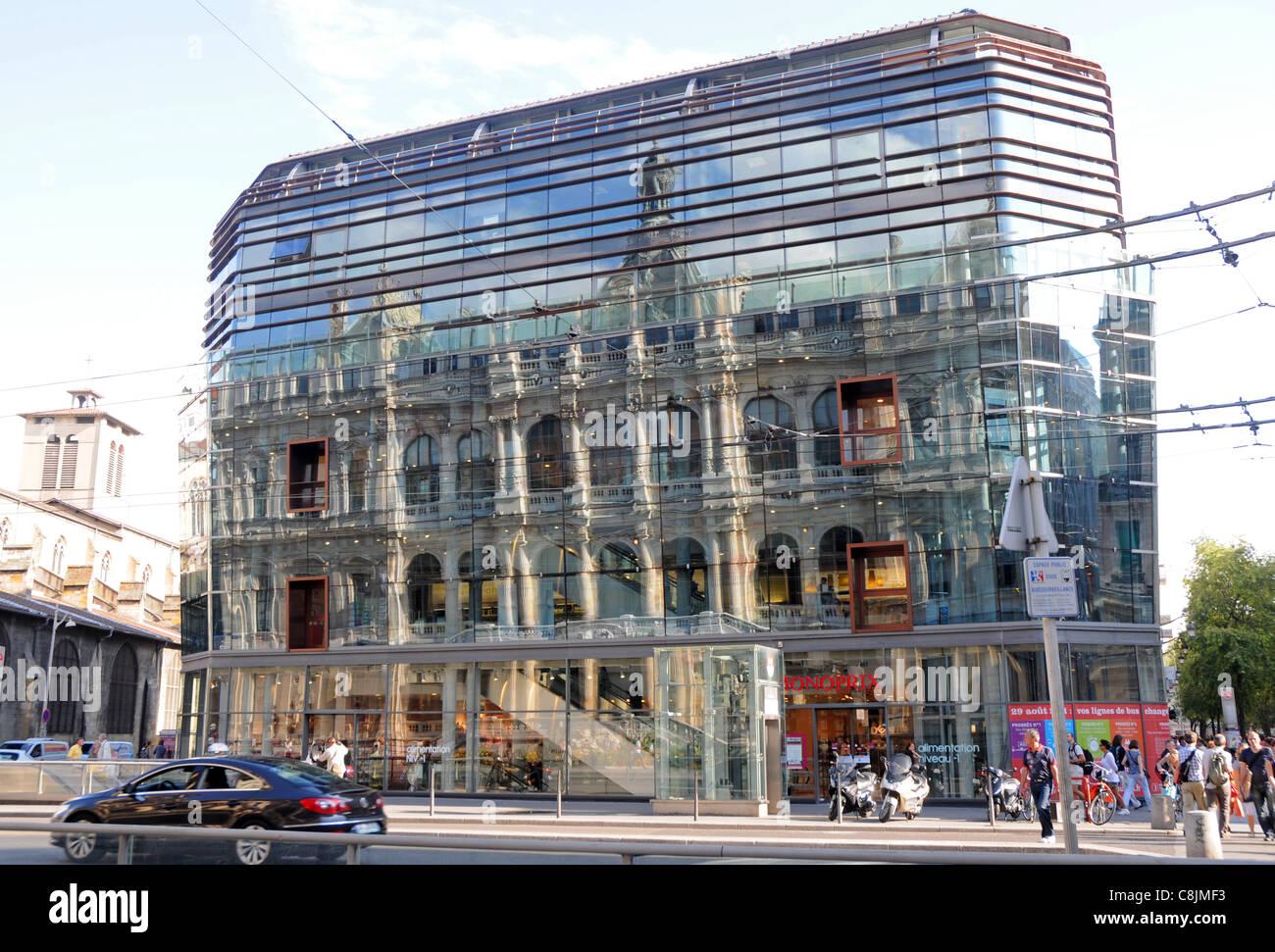 Grand Foyer Palais De La Bourse : Palais de la bourse reflected in glass facade of monoprix