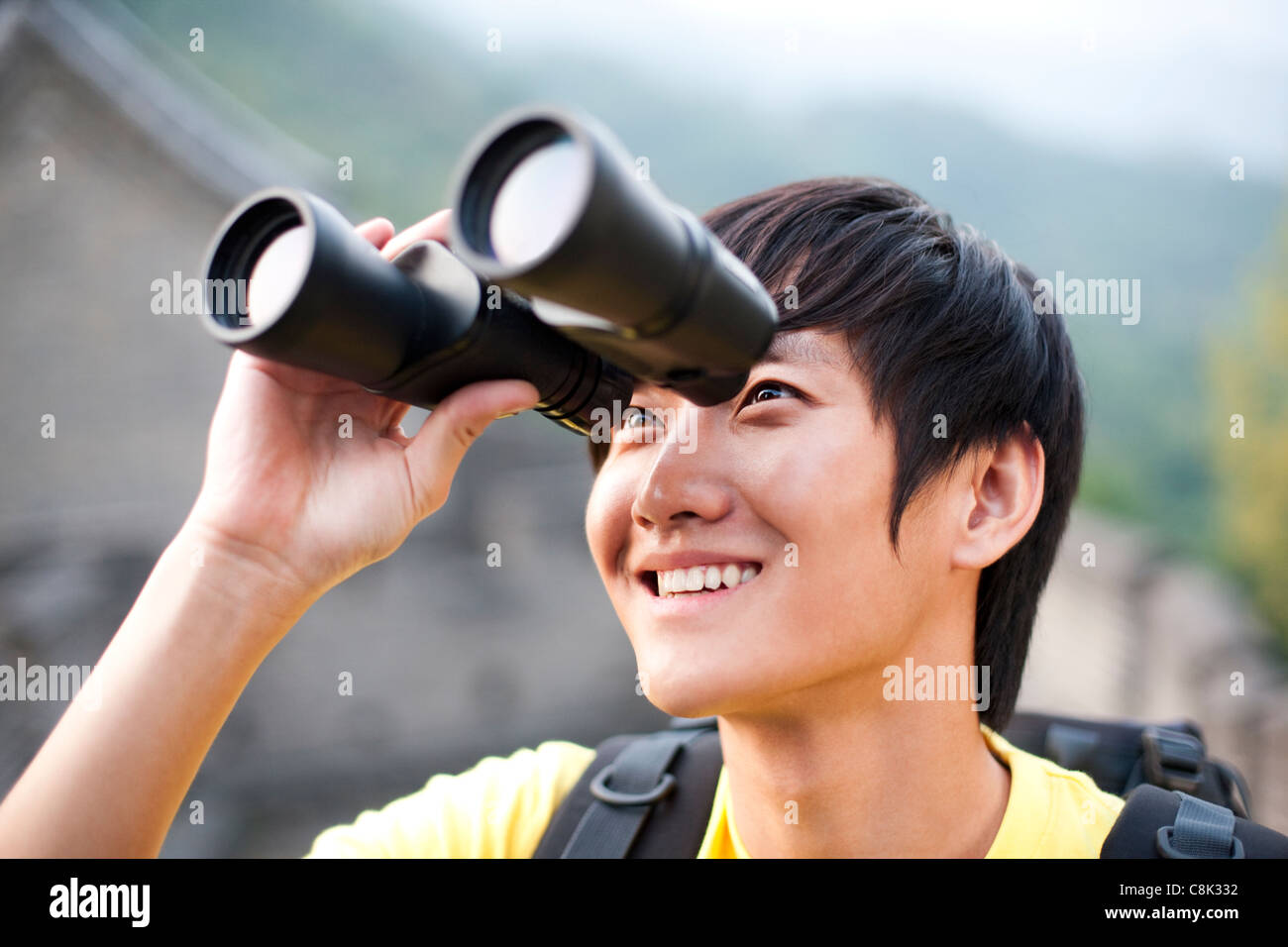 Young People Using Binoculars On The Great Wall Stock