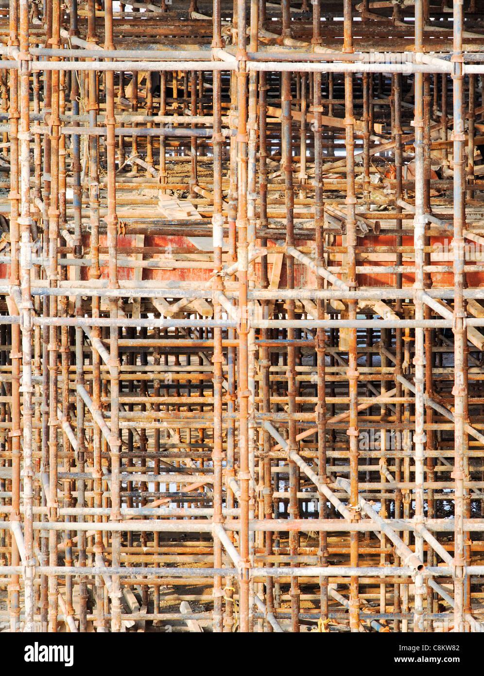 vertical portrait rusty scaffold scaffolding erection at n stock photo vertical portrait rusty scaffold scaffolding erection at n construction builder development crop margins texture background