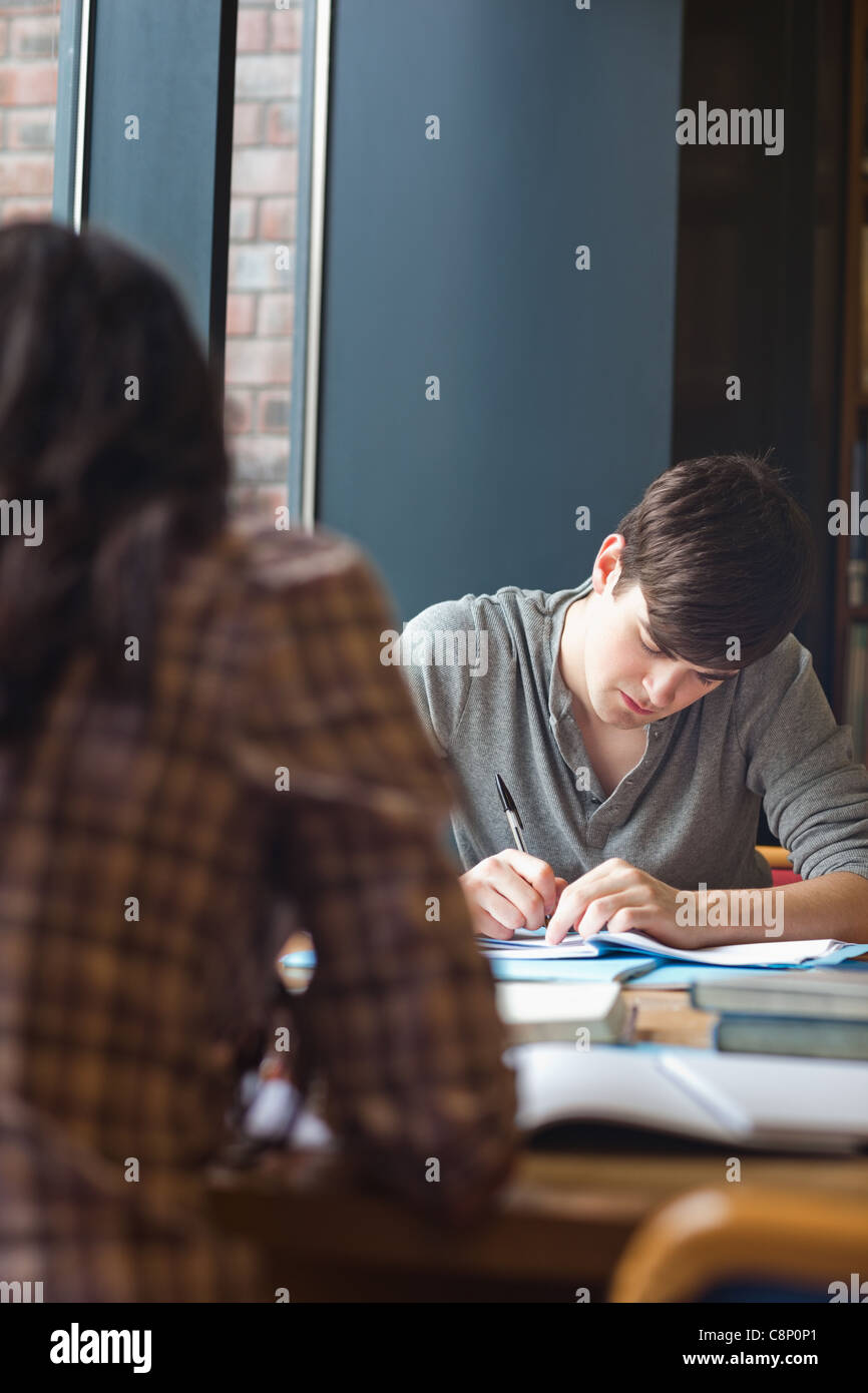 portrait of a student writing an essay stock photo royalty portrait of a student writing an essay
